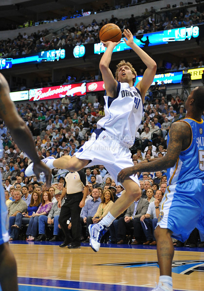 March 29th, 2010  <br /> Dallas Mavericks forward Dirk Nowitzki #41 drives to the basket<br /> in a game between the Denver Nuggets and the Dallas Mavericks at the American Airlines Center in Dallas, Texas.<br /> Dallas wins 109-93