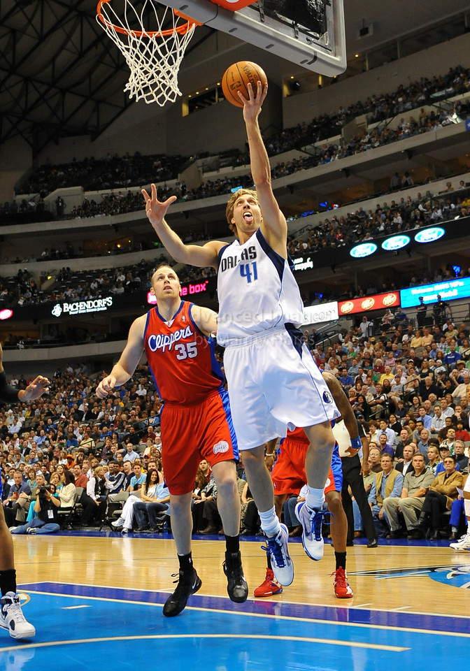 March 23rd, 2010  <br /> Dallas Mavericks forward Dirk Nowitzki #41 drives to the basket<br /> in a game between the Los Angeles Clippers and the Dallas Mavericks at the American Airlines Center in Dallas, Texas.<br /> Dallas wins 106-96