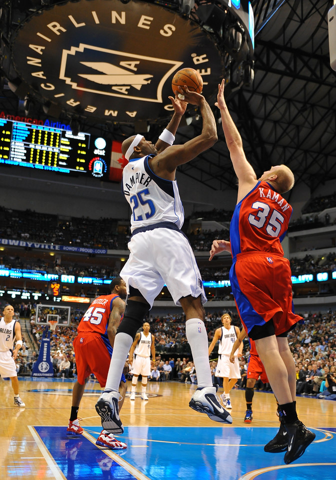 March 23rd, 2010  <br /> Dallas Mavericks center Erick Dampier #25 shoots over Los Angeles Clippers center Chris Kaman #35 in a game between the Los Angeles Clippers and the Dallas Mavericks at the American Airlines Center in Dallas, Texas.<br /> Dallas wins 106-96