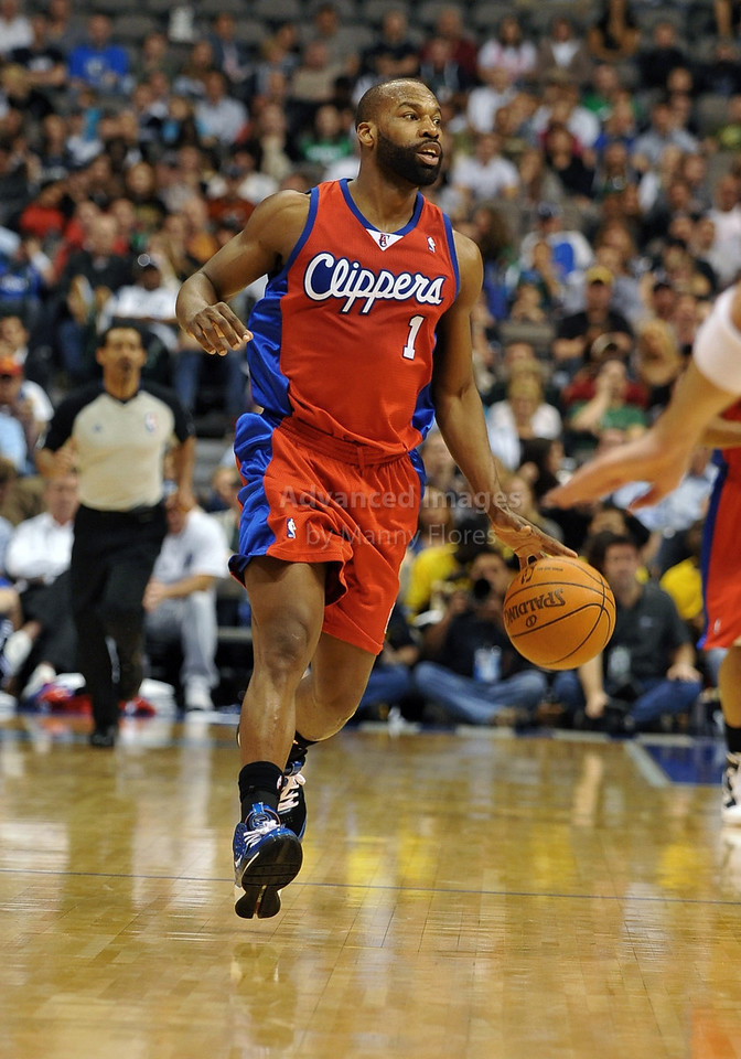 March 23rd, 2010  <br /> Los Angeles Clippers guard Baron Davis #1 brings the ball forward<br /> in a game between the Los Angeles Clippers and the Dallas Mavericks at the American Airlines Center in Dallas, Texas.<br /> Dallas wins 106-96