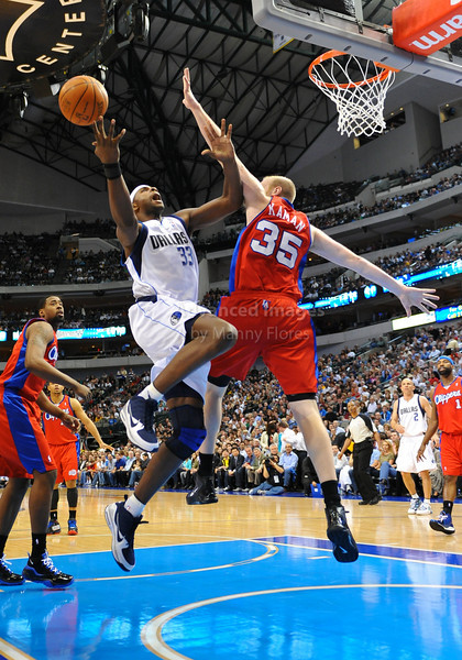March 23rd, 2010  <br /> Dallas Mavericks center Brendan Haywood drives against Los Angeles Clippers center Chris Kaman #35 in a game between the Los Angeles Clippers and the Dallas Mavericks at the American Airlines Center in Dallas, Texas.<br /> Dallas wins 106-96