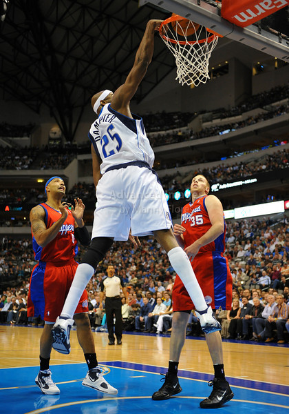 March 23rd, 2010  <br /> Dallas Mavericks center Erick Dampier #25 gets a dunk<br /> in a game between the Los Angeles Clippers and the Dallas Mavericks at the American Airlines Center in Dallas, Texas.<br /> Dallas wins 106-96