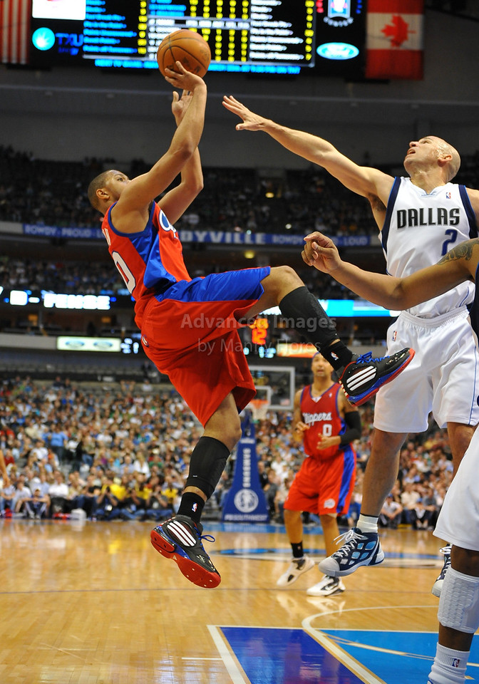 March 23rd, 2010  <br /> Los Angeles Clippers guard Eric Gordon #10 tries to shoot over Dallas Mavericks guard Jason Kidd #2 in a game between the Los Angeles Clippers and the Dallas Mavericks at the American Airlines Center in Dallas, Texas.<br /> Dallas wins 106-96
