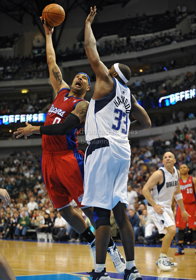 March 23rd, 2010  <br /> Los Angeles Clippers forward Drew Gooden #0 drives against Dallas Mavericks center Brendan Haywood #33 in a game between the Los Angeles Clippers and the Dallas Mavericks at the American Airlines Center in Dallas, Texas.<br /> Dallas wins 106-96