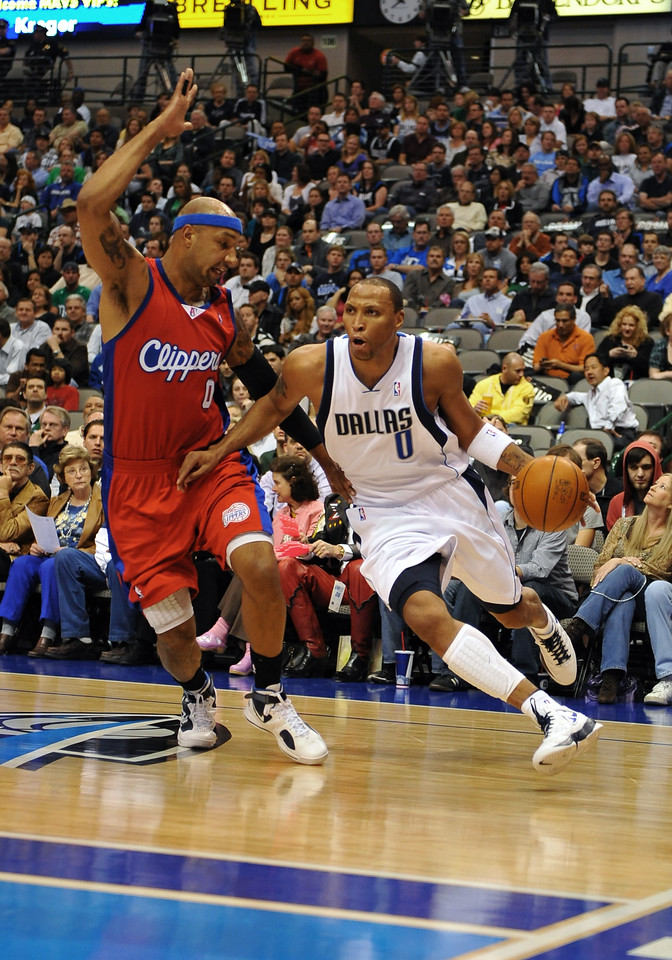 March 23rd, 2010  <br /> Dallas Mavericks forward Shawn Marion #0 drives to the basket against Los Angeles Clippers forward Drew Gooden #0<br /> in a game between the Los Angeles Clippers and the Dallas Mavericks at the American Airlines Center in Dallas, Texas.<br /> Dallas wins 106-96