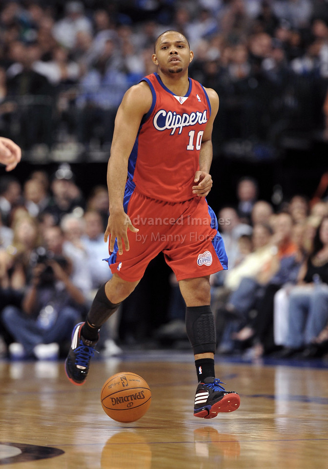 March 23rd, 2010  <br /> Los Angeles Clippers guard Eric Gordon #10 pushes the ball forward<br /> in a game between the Los Angeles Clippers and the Dallas Mavericks at the American Airlines Center in Dallas, Texas.<br /> Dallas wins 106-96