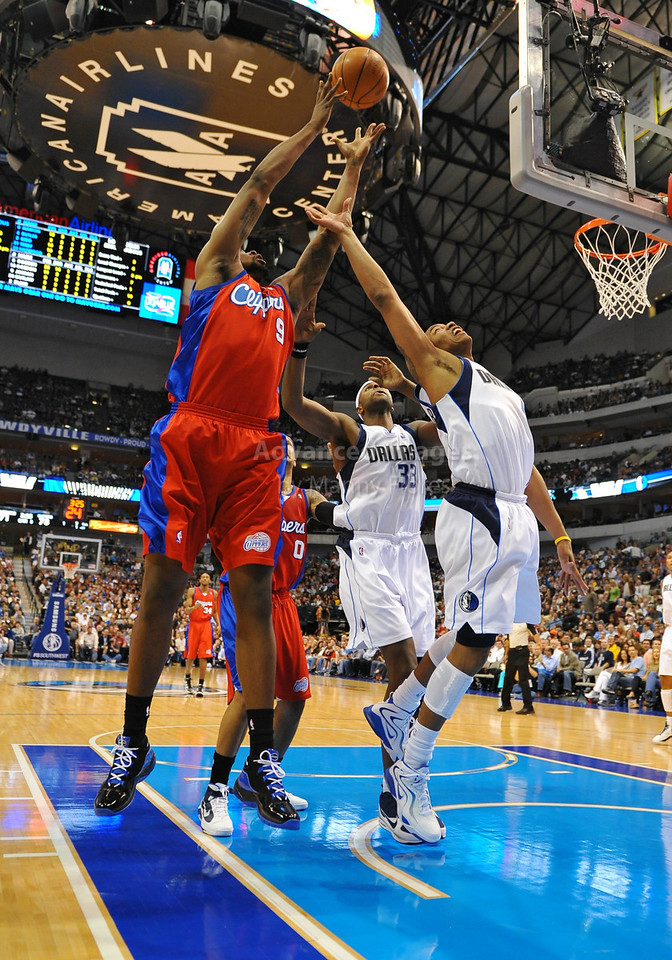 March 23rd, 2010  <br /> Los Angeles Clippers center DeAndre Jordan #9 takes a rebound away from Dallas Mavericks forward Caron Butler #4<br /> in a game between the Los Angeles Clippers and the Dallas Mavericks at the American Airlines Center in Dallas, Texas.<br /> Dallas wins 106-96