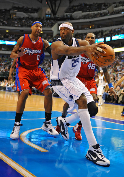 March 23rd, 2010  <br /> Dallas Mavericks center Erick Dampier #25 gets a rebound<br /> in a game between the Los Angeles Clippers and the Dallas Mavericks at the American Airlines Center in Dallas, Texas.<br /> Dallas wins 106-96