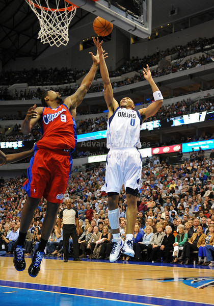 March 23rd, 2010  <br /> Dallas Mavericks forward Shawn Marion #0 drives to the basket against Los Angeles Clippers center DeAndre Jordan #9<br /> in a game between the Los Angeles Clippers and the Dallas Mavericks at the American Airlines Center in Dallas, Texas.<br /> Dallas wins 106-96