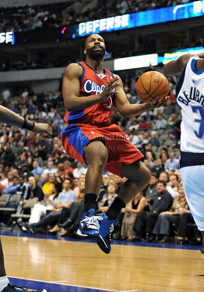 March 23rd, 2010  <br /> Los Angeles Clippers guard Baron Davis #1 drives to the basket<br /> in a game between the Los Angeles Clippers and the Dallas Mavericks at the American Airlines Center in Dallas, Texas.<br /> Dallas wins 106-96