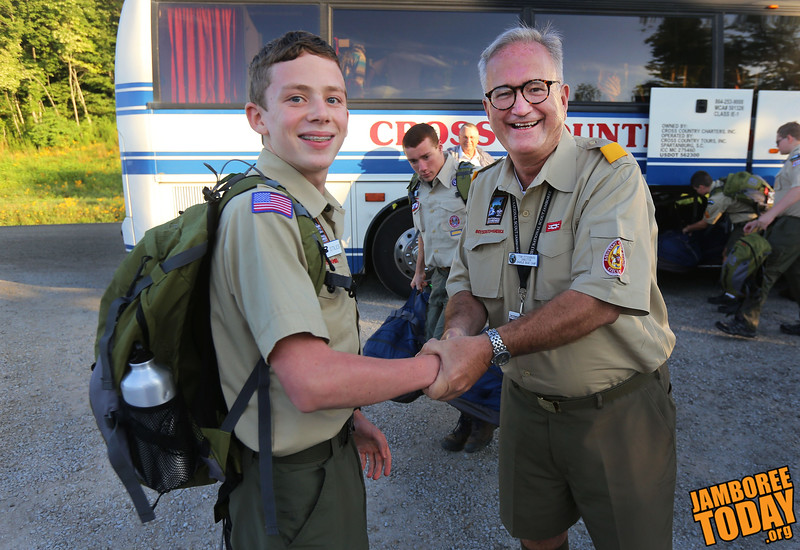Tom Fitzgibbon, director of Base Camp C,  shakes hands with first scout to arrive at the summit, Vance Stiles, 14, a First Class Scout from North Carolina, after the bus dropped off the scouts at their base camp C, Monday July 15, 2013.  Stiles is looking forward to meeting people and embarking on the adventure of the Jamboree.  He is also looking forward to his curriculum activity of the Mariners Challenge.  (BSA photo by Ron Kuenstler)