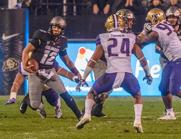 The NCAA PAC-12 Football game between the University of Colorado Buffaloes (CU) and the University of Washington Huskies (UW) at Folsom Field on the University of Colorado campus in Boulder, Colorado.  Final score of the game was CU Buffaloes - 10 and the Washington Huskies - 37.
