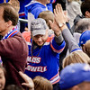 UMass Lowell fans high-five one another after scoring 5 goals against Cornell in the NCAA Northeast Regional Semifinals. SUN/Caley McGuane