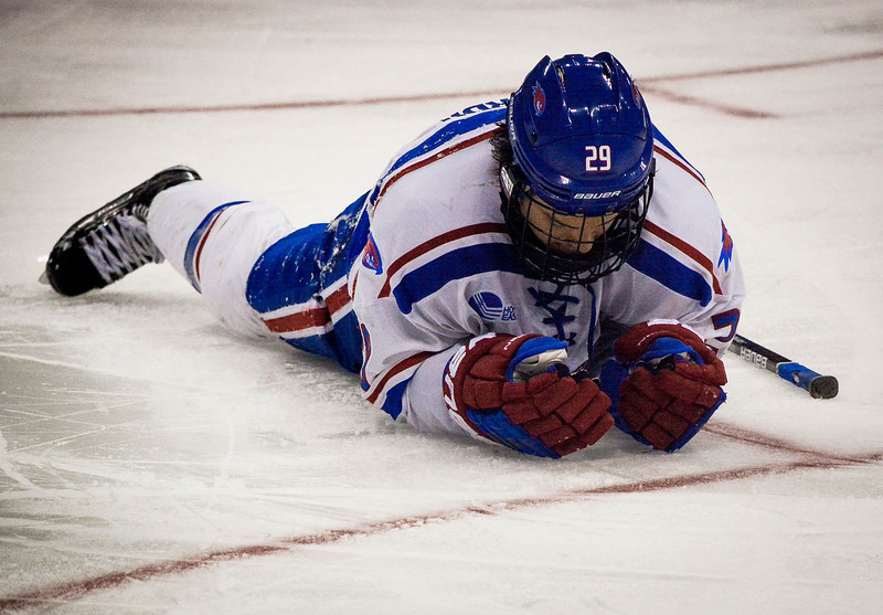 UMass Lowell's John Edwardh lies down on the rink in defeat after Notre Dame scores their 3rd goal in overtime. SUN/Caley McGuane