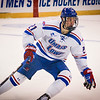 UMass Lowell's Jake Kamrass races after the puck in their game against Notre Dame. SUN/Caley McGuane