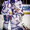UMass Lowell teammates Nick Marin (left) and Sean Cleary comfort golatender, Tyler Wall (33) after Notre Dame wins in overtime at the NCAA Regional Finals. SUN/Caley McGuane