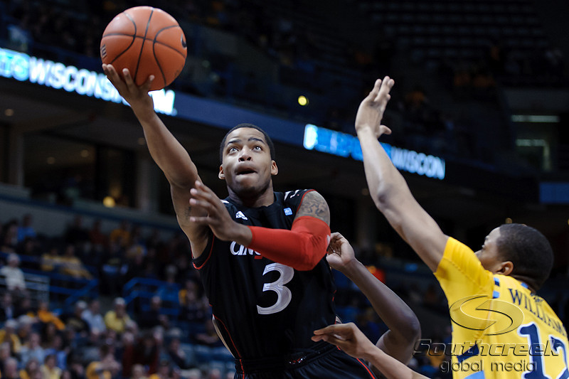 Cincinnati guard Dion Dixon (3) drives the lane to score during the game between the Marquette Golden Eagles and the Cincinnati Bearcats at the Bradley Center in Milwaukee, WI.  Cincinnati defeated Marquette 67-60.   Mandatory Credit: John Rowland / Southcreek Global