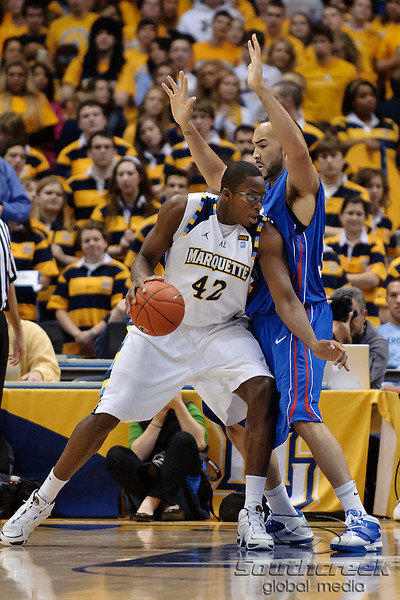 Marquette center Chris Otule (42) moves into the lane as DePaul center Krys Faber (33) defends during the game between the Marquette Golden Eagles and the DePaul Blue Demons at the Bradley Center in Milwaukee, WI. Marquette defeated DePaul 94-64.   Mandatory Credit: John Rowland / Southcreek Global