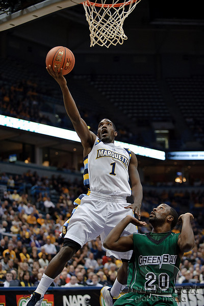 Marquette guard Darius Johnson-Odom (1) scores during the game between the Marquette Golden Eagles and the Green Bay Phoenix at the Bradley Center in Milwaukee, WI.  Marquette defeated Green Bay 89-69.   Mandatory Credit: John Rowland / Southcreek Global