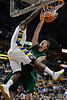 Marquette guard Darius Johnson-Odom (1) dunks over Green Bay forward Clayton Heuer (55) during the game between the Marquette Golden Eagles and the Green Bay Phoenix at the Bradley Center in Milwaukee, WI.  Marquette defeated Green Bay 89-69.   Mandatory Credit: John Rowland / Southcreek Global