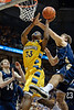 Marquette forward Jimmy Butler (33) is fouled by Notre Dame forward Tim Abromaitis (21) during the game between the Marquette Golden Eagles and the Notre Dame Fighting Irish at the Bradley Center in Milwaukee, WI. Marquette defeated Notre Dame 79-57.   Mandatory Credit: John Rowland / Southcreek Global