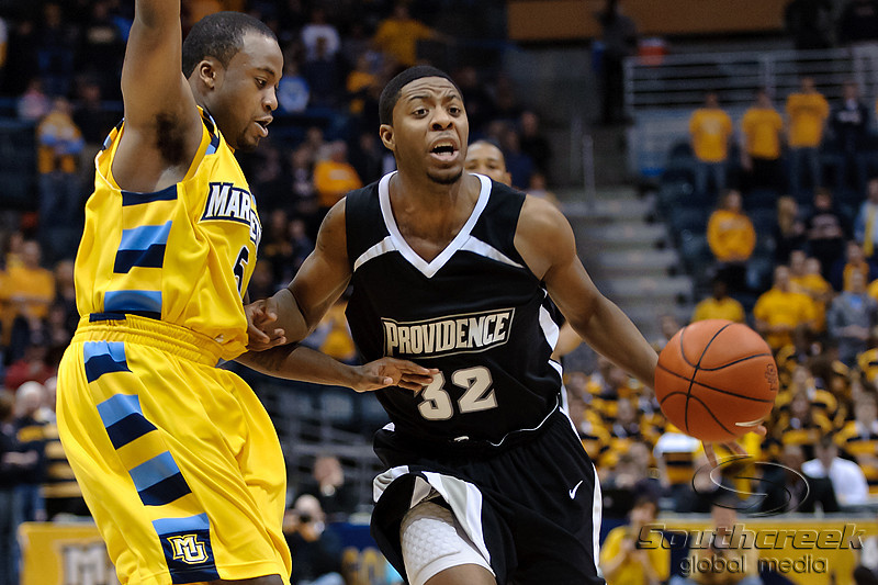 Providence guard Vincent Council (32) droves past Marquette guard Junior Cadougan (5) during the game between the Marquette Golden Eagles and the Providence Friars at the Bradley Center in Milwaukee, WI.  Marquette defeated Providence 86-62.   Mandatory Credit: John Rowland / Southcreek Global