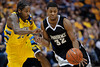 Providence guard Vincent Council (32) drives past Marquette guard Dwight Buycks (23) during the game between the Marquette Golden Eagles and the Providence Friars at the Bradley Center in Milwaukee, WI.  Marquette defeated Providence 86-62.   Mandatory Credit: John Rowland / Southcreek Global