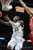 Marquette guard Dwight Buycks (23) lays it in during the game between the Marquette Golden Eagles and the South Dakota Coyotes at the Bradley Center in Milwaukee, WI.  Marquette defeated South Dakota 82-69.   Mandatory Credit: John Rowland / Southcreek Global