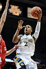 Marquette guard Vander Blue (2) goes high to score during the game between the Marquette Golden Eagles and the South Dakota Coyotes at the Bradley Center in Milwaukee, WI.  Marquette defeated South Dakota 82-69.   Mandatory Credit: John Rowland / Southcreek Global