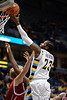 Marquette guard Dwight Buycks (23) goes up high to make the basket during the game between the Marquette Golden Eagles and the South Dakota Coyotes at the Bradley Center in Milwaukee, WI.  Marquette defeated South Dakota 82-69.   Mandatory Credit: John Rowland / Southcreek Global