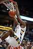 Marquette center Chris Otule (42) slams the ball home during the game between the Marquette Golden Eagles and the South Dakota Coyotes at the Bradley Center in Milwaukee, WI.  At the half, Marquette leads South Dakota 43-29.   Mandatory Credit: John Rowland / Southcreek Global