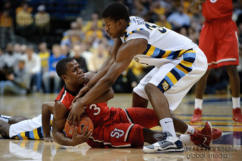 St. John's guard Malik Boothe (3) and Marquette forward Jimmy Butler (33) battle for a loose ball during the game between the Marquette Golden Eagles and the St. John's Red Storm at the Bradley Center in Milwaukee, WI. At halftime, Marquette and St. John's are tied at 38.   Mandatory Credit: John Rowland / Southcreek Global