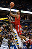 St. John's forward D.J. Kennedy (1) is fouled by Marquette guard Junior Cadougan (5) while attempting a layup during the game between the Marquette Golden Eagles and the St. John's Red Storm at the Bradley Center in Milwaukee, WI. St. John's defeated Marquette 80-68.   Mandatory Credit: John Rowland / Southcreek Global