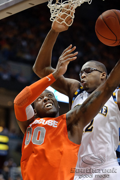 Syracuse forward Rick Jackson (00) scores a basket past Marquette center Chris Otule (42) during the game between the Marquette Golden Eagles and the Syracuse Orange at the Bradley Center in Milwaukee, WI. Marquette defeated Syracuse 76-70.   Mandatory Credit: John Rowland / Southcreek Global