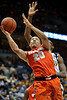 Syracuse guard Brandon Triche (20) drives the lane for a basket during the game between the Marquette Golden Eagles and the Syracuse Orange at the Bradley Center in Milwaukee, WI. Marquette defeated Syracuse 76-70.   Mandatory Credit: John Rowland / Southcreek Global