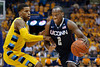 Connecticut guard Donnell Beverly (2) drives past Marquette guard Vander Blue (2) during the game between the Marquette Golden Eagles and the Connecticut Huskies at the Bradley Center in Milwaukee, WI. UConn defeated Marquette 76-68.   Mandatory Credit: John Rowland / Southcreek Global
