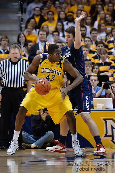Marquette center Chris Otule (42) posts up Connecticut forward Tyler Olander (10) in the lane during the game between the Marquette Golden Eagles and the Connecticut Huskies at the Bradley Center in Milwaukee, WI. UConn defeated Marquette 76-68.   Mandatory Credit: John Rowland / Southcreek Global