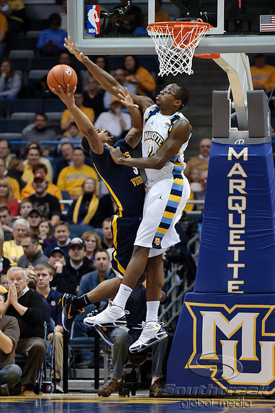 Marquette center Chris Otule (42) blocks a shot attempt by West Virginia guard Casey Mitchell (3) during the game between the Marquette Golden Eagles and the West Virginia Mountaineers at the Bradley Center in Milwaukee, WI. Marquette defeated West Virginia 79-74.   Mandatory Credit: John Rowland / Southcreek Global