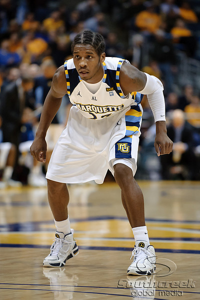 Marquette guard Dwight Buycks (23) plays defense during the game between the Marquette Golden Eagles and the West Virginia Mountaineers at the Bradley Center in Milwaukee, WI. Marquette defeated West Virginia 79-74.   Mandatory Credit: John Rowland / Southcreek Global