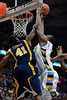 Marquette center Chris Otule (42) is fouled by West Virginia forward John Flowers (41) while trying to dunk the ball during the game between the Marquette Golden Eagles and the West Virginia Mountaineers at the Bradley Center in Milwaukee, WI. Marquette defeated West Virginia 79-74.   Mandatory Credit: John Rowland / Southcreek Global