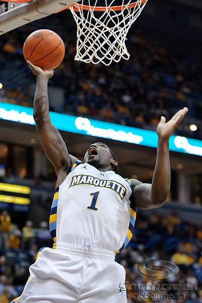 Marquette guard Darius Johnson-Odom (1) scores a basket during the game between the Marquette Golden Eagles and the West Virginia Mountaineers at the Bradley Center in Milwaukee, WI. Marquette defeated West Virginia 79-74.   Mandatory Credit: John Rowland / Southcreek Global