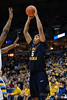 West Virginia forward Kevin Jones (5) looks to past into the post during the game between the Marquette Golden Eagles and the West Virginia Mountaineers at the Bradley Center in Milwaukee, WI. Marquette defeated West Virginia 79-74.   Mandatory Credit: John Rowland / Southcreek Global