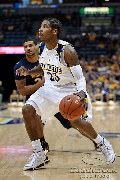 Marquette guard Dwight Buycks (23) looks for a shot during the game between the Marquette Golden Eagles and the West Virginia Mountaineers at the Bradley Center in Milwaukee, WI. Marquette defeated West Virginia 79-74.   Mandatory Credit: John Rowland / Southcreek Global
