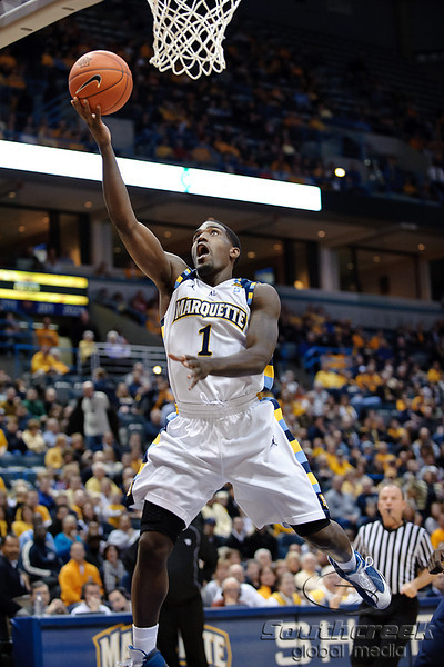 Marquette guard Darius Johnson-Odom (1) scores on a layup during the game between the Marquette Golden Eagles and the West Virginia Mountaineers at the Bradley Center in Milwaukee, WI. Marquette defeated West Virginia 79-74.   Mandatory Credit: John Rowland / Southcreek Global