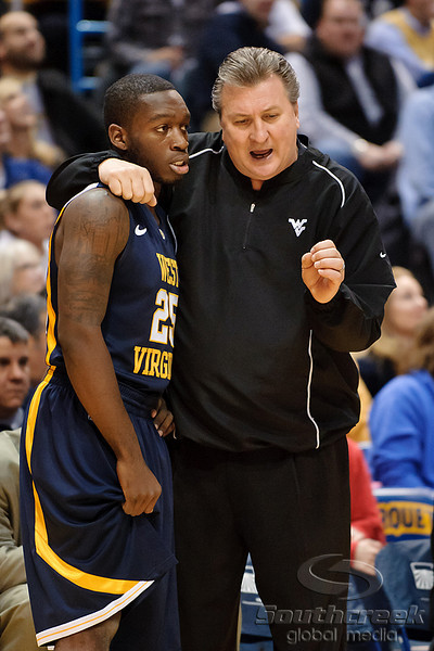 West Virginia head coach Bob Huggins talks with West Virginia guard Darryl Bryant (25) during the game between the Marquette Golden Eagles and the West Virginia Mountaineers at the Bradley Center in Milwaukee, WI. Marquette defeated West Virginia 79-74.   Mandatory Credit: John Rowland / Southcreek Global