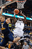 Marquette guard Darius Johnson-Odom (1) avoids the block attempt of West Virginia forward Cam Thoroughman (2), and scores a basket during the game between the Marquette Golden Eagles and the West Virginia Mountaineers at the Bradley Center in Milwaukee, WI. Marquette defeated West Virginia 79-74.   Mandatory Credit: John Rowland / Southcreek Global