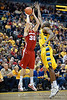 Wisconsin forward Jon Leuer (30) hits a 3 point FG over Marquette center Chris Otule (42) during the game between the Marquette Golden Eagles and the Wisconsin Badgers at the Bradley Center in Milwaukee, WI. Wisconsin defeated Marquette 69-64.   Mandatory Credit: John Rowland / Southcreek Global