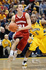 Wisconsin guard Josh Gasser (21) drives past Marquette guard Junior Cadougan (5) during the game between the Marquette Golden Eagles and the Wisconsin Badgers at the Bradley Center in Milwaukee, WI. Wisconsin defeated Marquette 69-64.   Mandatory Credit: John Rowland / Southcreek Global