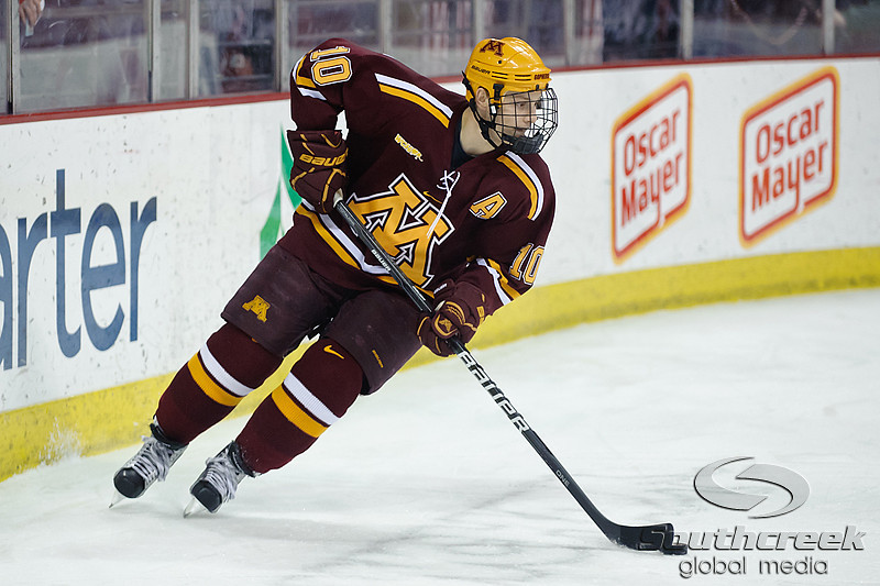 Minnesota defenseman Aaron Ness (10) brings the puck up ice during the game between the Minnesota Golden Gophers and the Wisconsin Badgers at the Kohl Center in Madison, WI.  Minnesota defeated Wisconsin 5-2.   Mandatory Credit: John Rowland / Southcreek Global