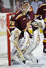 Minnesota goalie Kent Patterson (35) watches the action in the corner during the game between the Minnesota Golden Gophers and the Wisconsin Badgers at the Kohl Center in Madison, WI.  Minnesota defeated Wisconsin 5-2.   Mandatory Credit: John Rowland / Southcreek Global